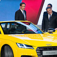 Viktor Orban (2nd R) prime minister of Hungary reacts to the high tech dashboard of the new Audi TT Roadster introduced during the official production launch event in the Audi factory in Gyor (about 120 km West of Budapest), Hungary on November 05, 2014. ATTILA VOLGYI
