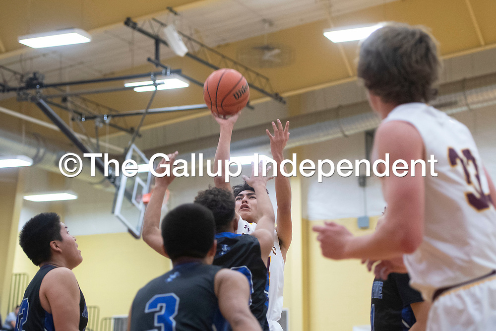 Rehoboth Lynx Talon West (14) takes a jump shot against Navajo Pine Warriors Tuesday evening in Rehoboth.