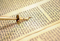"""Rabbi Marci Delbick of Temple Beth El uses a ceremonial pointer, called a """"yad,"""" or hand, to read the Torah. Temple Beth El's ark is designed to house these holy writings."""