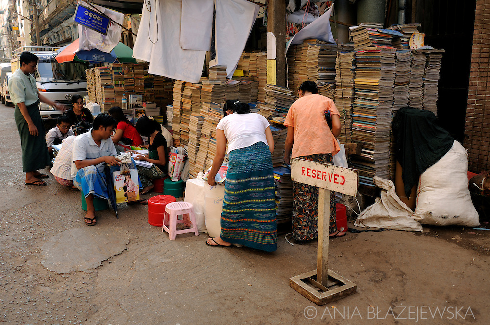 Myanmar/Burma. People choosing books in the bookshop situated in one of the streets of Yangon.