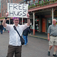 USA, Washington, Seattle. Free Hugs at Pike Place Market.