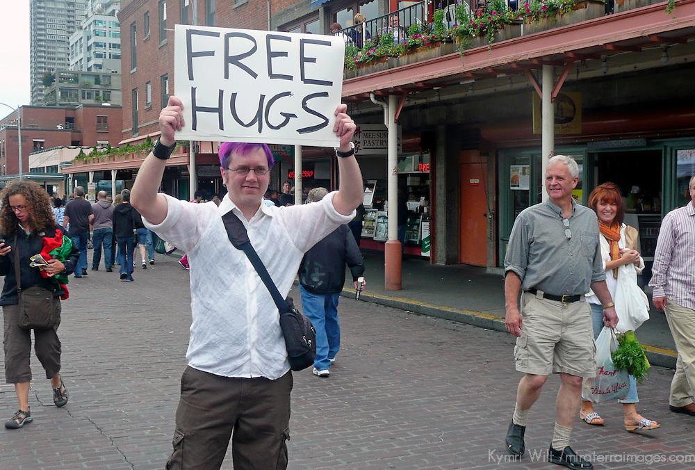 USA, Washington, Seattle. Free Hugs at Pike Place Market.