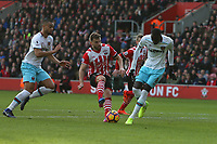 Football - 2016 / 2017 Premier League - Southampton vs. West Ham United<br /> <br /> Southampton's Jay Rodriguez and Cheikhou Kouyate of West Ham United make contact with the ball at the same time forcing the Saints player off at half time at St Mary's Stadium Southampton England<br /> <br /> COLORSPORT/SHAUN BOGGUST