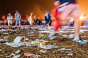 Love the Farm-Leave notrace, ironic as people trudge back past the litter at the Other Stage - The 2017 Glastonbury Festival, Worthy Farm. Glastonbury, 25 June 2017