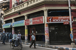 KOLKATA, Nov. 9, 2016 (Xinhua) -- Indian people walk past closed ATMs of various banks in Kolkata, capital of eastern Indian state West Bengal, Nov. 9, 2016. India Tuesday night abolished currency notes of 500 and 1,000 denomination in one of the biggest revolutionary monetary reforms since independence, aimed at curbing the menace of black money. All ATMs and banks remain shut on Wednesday and Thursday. (Xinhua/Tumpa Mondal).****Authorized by ytfs* (Credit Image: © Tumpa Mondal/Xinhua via ZUMA Wire)