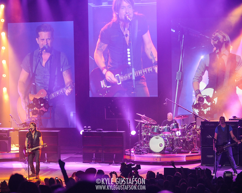 COLUMBIA, MD - August 8th, 2013 -   Keith Urban (left) performs at Merriweather Post Pavilion as part of his Light The Fuse Tour. Urban's eighth studio album, Fuse, will be released in September.(Photo by Kyle Gustafson/For The Washington Post)