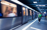 BUCHAREST, ROMANIA - October 1, 2012: Woman walking in a subway station in Bucharest