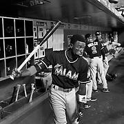 Dee Gordon, MIami Marlins, in the dugout preparing to bat during the New York Mets Vs Miami Marlins MLB regular season baseball game at Citi Field, Queens, New York. USA. 16th September 2015. Photo Tim Clayton