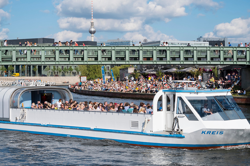Tourist city boat tour on Spree River in summer in Berlin, Germany