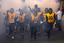 California players emerge from the tunnel before an NCAA college football game against Nevada, Saturday, Sept. 4, 2021, in Berkeley, Calif. (AP Photo/D. Ross Cameron)