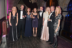 Left to right, LADY KINVARA BALFOUR, GEORGE FRANKS,the COUNTESS OF BALFOUR, LADY WILLA FRANKS, CHARLIE WIGAN, LADY JUBIE WIGAN, the EARL OF BALFOUR and LADY CANDIDA BALFOUR at the Sugarplum Dinner - The event was for the launch of Sugarplum Children, a new website and fundraising initiative for children who live with type 1 diabetes, and to raise money for JDRF (Juvenile Diabetes Research Foundation) held at One Mayfair, 13A North Audley Street, London on 20th November 2013.