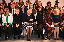 The Duchess of Cornwall (centre) chats with British Vogue Editor Edward Enninful on the front row during a visit to London Fashion Week at the BFC Show Space, London.