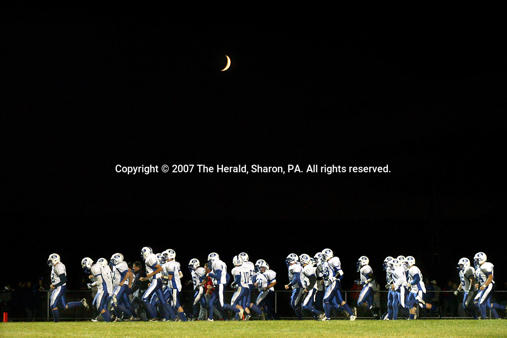The Sharpsville Blue Devils march onto the field after halftime during their game at West Middlesex.