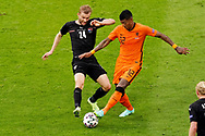 Konrad Laimer of Austria battles for possession with Patrick van Aanholt of the Netherlands during the UEFA Euro 2020, Group C football match between Netherlands and Austria on June 17, 2021 at the Johan Cruijff ArenA in Amsterdam, Netherlands - Photo Andre Weening / Orange Pictures / ProSportsImages / DPPI