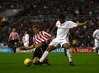 Photo: Andrew Unwin.<br />Sunderland v Luton Town. Coca Cola Championship. 09/12/2006.<br />Sunderland's Daryl Murphy (L) tries to win the ball from Luton's Lewis Emanuel (R).
