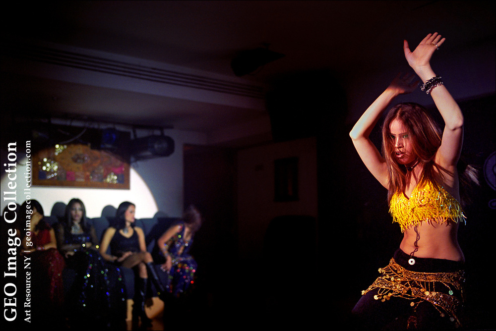 A South Asian dancer gyrates in a Dubai night club where women from Africa, Central Asia, Russia, and Asia are widely available for sex for a price. Dubai and its neighbors have been roundly condemned for human rights groups, the U.S. State Department, and the European Union for aiding in the exploitation and trafficking of women and children.
