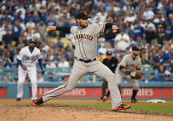 March 29, 2018 - Los Angeles, CA, U.S. - LOS ANGELES, CA - MARCH 29: San Francisco Giants Pitcher Hunter Strickland (60) throws a pitch in the 9th inning during the MLB opening day game between the San Francisco Giants and the Los Angeles Dodgers on March 29, 2018 at Dodger Stadium in Los Angeles, CA. (Photo by Chris Williams/Icon Sportswire) (Credit Image: © Chris Williams/Icon SMI via ZUMA Press)