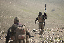 Licensed to London News Pictures. 20/02/2017. Albu Saif, Iraq. An Iraqi Emergency Response Soldier, carrying an RPG, runs towards the village of Albu Saif as his battalion assaults the ISIS held settlement during the offensive to retake western Mosul from Islamic State militants.<br /> <br /> The settlement of Albu Saif is located on high ground overlooking Mosul Airport and as such is a strategic point that needs to be taken as part of the operation to retake the western side of Mosul. Photo credit: Matt Cetti-Roberts/LNP