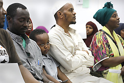 August 4, 2017 - San Diego, CA, USA - Ahmed Abdullah, center, age 5, is sandwiched between his father Mohamed Abdullah, in light clothing and others at the gathering of the Somali Bantu Association of America.  Both came from Ethiopia. President Trump has proposed changes in immigration policy that may affect many. (Credit Image: © John Gastaldo via ZUMA Wire)