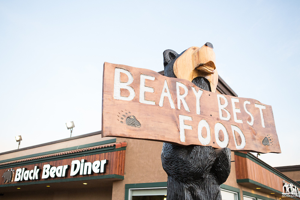 Large black bear sculptures crafted by Ray Schulz fill the Black Bear Diner parking lot and entrance in Milpitas, Calif. on July 11, 2012.  Photo by Stan Olszewski/SOSKIphoto.