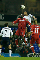 Photo. Jed Wee.<br /> Tottenham Hotspur v Middlesbrough, Carling Cup, White Hart Lane, London. 17/12/2003.<br /> Middlesbrough's Michael Ricketts (L) jumps with Spurs' Dean Richards.