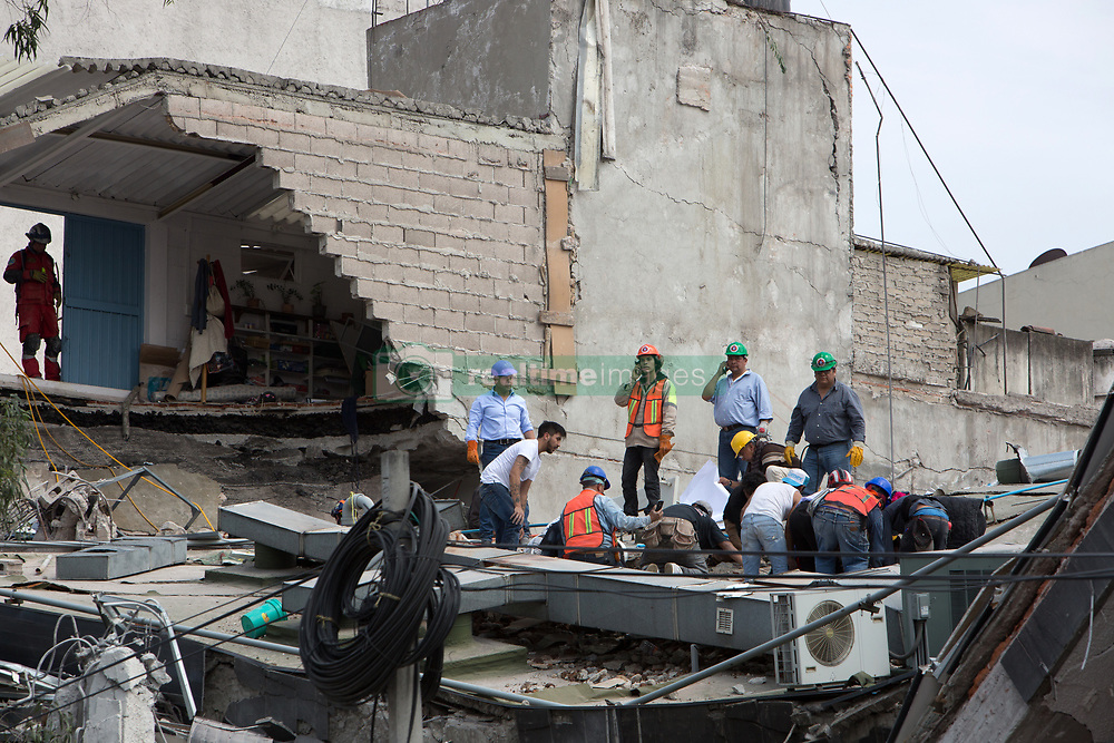 Rescue workers and residents dug through the rubble of collapsed buildings seeking survivors after a quake rattled Mexico City, Mexico on September 19, 2017. The 7.1 magnitude earthquake rocked Central Mexico, killing dozens people and causing serious damage to buildings in the capital. The worst earthquake in the history of Mexico occurred on September 19, 1985, killing nearly 10,000 people. (Photo by Bénédicte Desrus/Sipa USA)