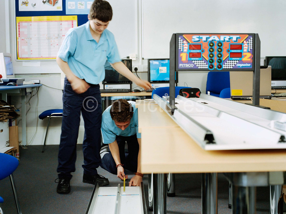 Andrew Lees, 16; Thomas Simpson, 17 working on the development of Team Pulse's miniature Formula One car in preparation of the F1 In School's World Championship. At this point they have no idea they are going to go to become world champions, meet Bernie Ecclestone, Lewis Hamilton and compete with the F1's boffins behind world champs Ferrari:  a race, which, of course they won.