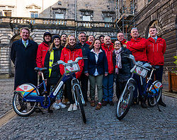 City Chambers, Edinburgh, Scotland, United Kingdom, Just Eat E-bikes: A new fleet of 163 rentable e-bikes are launched and integrated into the capital's existing cycle hire scheme by Just Eat Cycles. Edinburgh will now have the largest docked e-bike fleet in UK. Pictured: Just Eat bike staff with George Lowder, Chief Executive of Transport for Edinburgh (far left) and Katherine Soane (centre), Senior Project Officer, TfE Cycle Hire.<br /> Sally Anderson | EdinburghElitemedia.co.uk