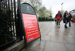Hyde Park, London, 20/04/2014<br /> People attending a pro-cannabis rally held in Hyde Park, central London, walk past a police sign warning of prosecution if caught in possession of drugs.<br /> Photo: Anna Branthwaite/LNP