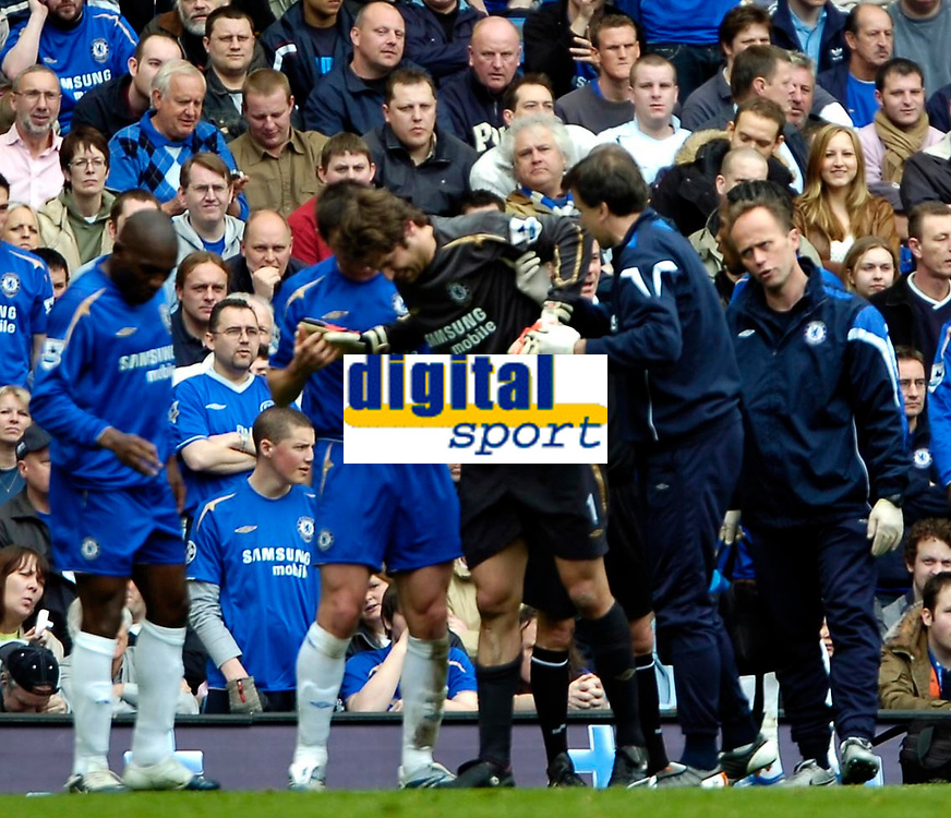 Photo: Ed Godden.<br />Chelsea v Everton. The Barclays Premiership. 17/04/2006.<br />Chelsea keeper, Petr Cech (C) receives help for an injury. He was later subsituted at half-time.