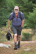 Kerhonkson, New York - Hikers move through Minnewaska State Park Preserve during the Shawangunk Ridge Trail Run/Hike 20-mile race on Sept. 20, 2014.