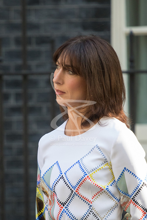 Downing Street, London, June 24th 2016. British Prime Minister David Cameron appears before the world's press gathered in Downing Street and announces that he will step aside with a new Prime Minister in place before the Party Conference, after the country votes to leave the European Union. PICTURED: Samantha Cameron watches as her husband announces his resignation as British Prime Minister.