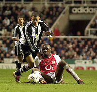 Photo. Jed Wee<br />Newcastle United v Arsenal, FA Barclaycard Premiership, St. James' Park, Newcastle. 09/02/2003.<br />Arsenal's Patrick Viera (R) and Newcastle's Kieron Dyer scrap for possession.