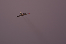 Private jet takes off from the airport at dusk