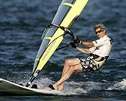 U.S. Democratic presidential nominee John Kerry (D-MA) windsurfs off the coast of Nantucket, August 30,  2004.       REUTERS/Jim Young