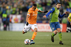 November 30, 2017 - Seattle, Washington, U.S - Soccer 2017: Houston's MAURO MANOTAS (19) attempts a shot against Seattle's VICTOR RODRIGUEZ (8) as the Houston Dynamo play the Seattle Sounders in the 2nd leg of the MLS Western Conference Finals match at Century Link Field in Seattle, WA. (Credit Image: © Jeff Halstead via ZUMA Wire)