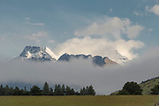 Landscape with view of the majestic Humboldt Mountains hidden behind a fog, Glenorchy, South Island, New Zealand