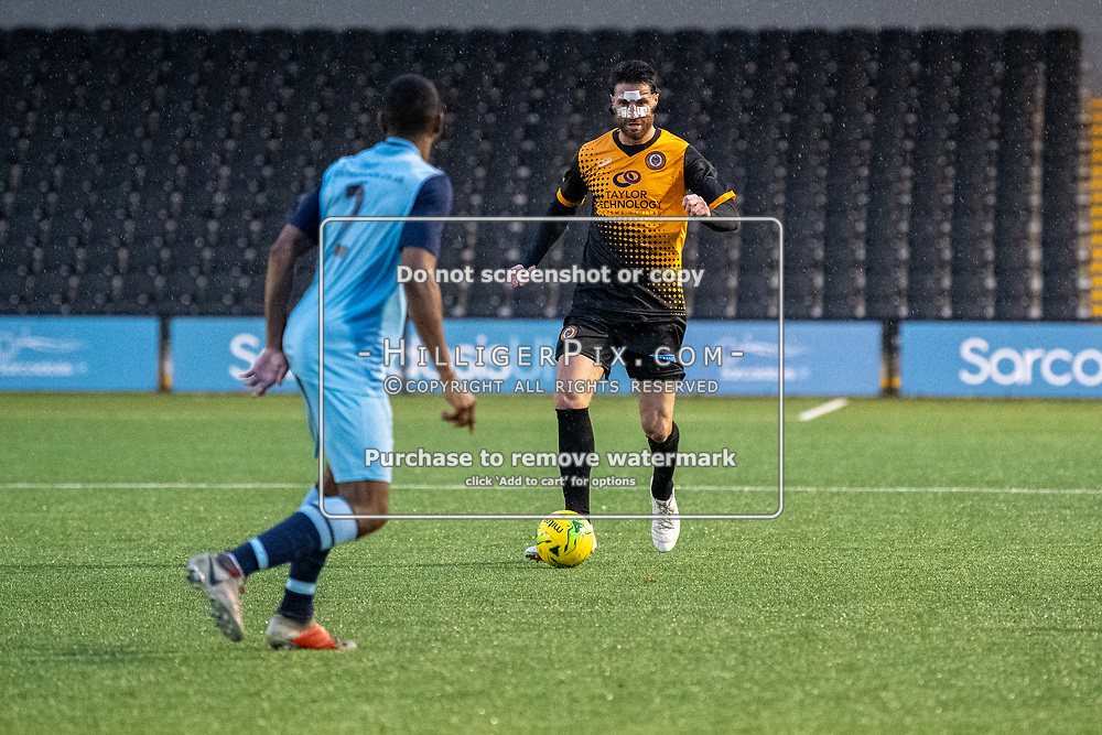 BROMLEY, UK - NOVEMBER 09: Jay Leader, of Cray Wanderers FC, brings the ball out of defence during the BetVictor Isthmian Premier League match between Cray Wanderers and Cheshunt at Hayes Lane on November 9, 2019 in Bromley, UK. <br /> (Photo: Jon Hilliger)