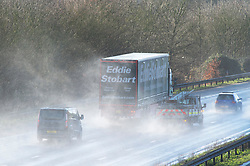 © Licensed to London News Pictures 27/12/2020.        Swanley, UK. Vehicles on the M25 near Swanley in Kent spray up surface rain water from storm Bella. Storm Bella has battered Kent with gale force winds and heavy rain flooding roads and bringing down trees. Photo credit:Grant Falvey/LNP
