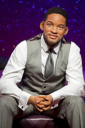 © Licensed to London News Pictures. 22/05/2013. London, UK. A waxwork figure of rapper, actor and producer Will Smith is seen on a sofa alongside actor George Clooney and Harry Potter actress Emma Watson (not shown) as the former Fresh Prince of Bel Air star takes his place in Madame Tussauds 'A-List' party in London today (22/05/2013). Photo credit: Matt Cetti-Roberts/LNP