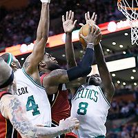 18 March 2013: Miami Heat small forward LeBron James (6) goes for the layup between Boston Celtics power forward Chris Wilcox (44) and Boston Celtics power forward Jeff Green (8) during the Miami Heat 105-103 victory over the Boston Celtics at the TD Garden, Boston, Massachusetts, USA.