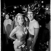 Young couple partying in Greenwich Village, NYC during Halloween.
