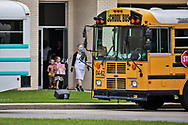 Sunday, March 29, 202, Congregants headed to buses to depart the  Life Tabernacle Church after atteneding a service led by  Pastor Tony Spell  who defied Louisiana Gov. John Bel Edwards shelter-in-place order  despite the coronavirus Pandemic.