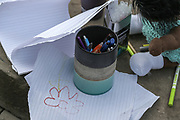 13th, March, 2021. Cheltenham, England. A collection of pens and paper at the flower laying event for Sarah Everard.