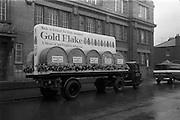 17/03/1965<br /> 03/17/1965<br /> 17 March 1965<br /> NAIDA St. Patrick's Day Parade, Dublin. W. D.& H. O. Wills float for the parade parked outside the Wills Tobacco factory on the South Circular Road, the truck is a Dublin Port and Docks Scammmel Scarab.