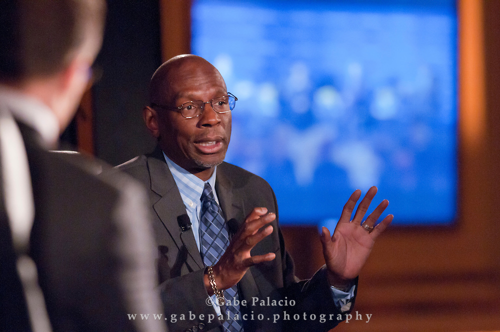 Geoffrey Canada, CEO of Harlem Children's Zone, speaks to Robert Frank, Senior Writer of the Wall Street Journal,  during The WSJ Future of New York series on Philanthropy in New York fin New York City on April 8, 2011.  (photo by Gabe Palacio)