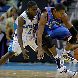 Oct 10, 2009; New Orleans, LA, USA;  New Orleans Hornets rookie guard Darren Collison (2) defends Oklahoma City Thunder guard Kevin Ollie (7) during a preseason game at the New Orleans Arena. The Hornets defeated the Thunder 88-79. Mandatory Credit: Derick E. Hingle-US PRESSWIRE