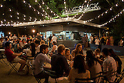 Diners sit at tables outside the Shake Shack in Madison Square Park.