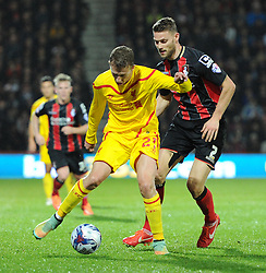 Bournemouth's Simon Francis marks Liverpool's Lucas Leiva - Photo mandatory by-line: Paul Knight/JMP - Mobile: 07966 386802 - 17/12/2014 - SPORT - Football - Bournemouth - Goldsands Stadium - AFC Bournemouth v Liverpool - Capital One Cup