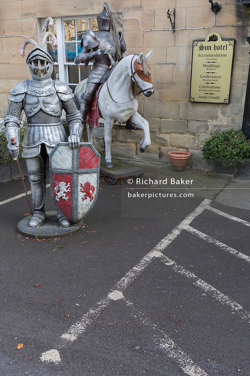 Medieval knights in suits of armour guard the entrance of the Sun Hotel, on 26th September 2017, in Warkworth, Northumberland, England. Warkworth is a village in Northumberland, England. It is probably best known for its well-preserved medieval castle, church and hermitage.